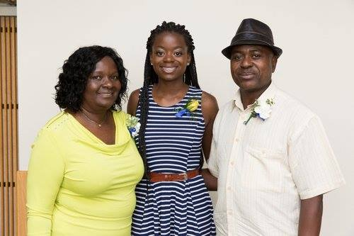 Kayiza pictured with her parents.