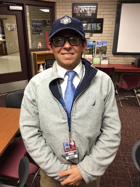 Alejandro Bello-Munoz, a senior at Jenks High School, proudly wears his Navy hat. Bello-Munoz is heading to the U.S. Naval Academy in June to begin his freshman year.